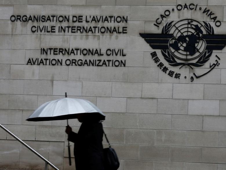A pedestrian walks past the International Civil Aviation Organization (ICAO) headquarters building in Montreal, Quebec, Canada June 16, 2017.  REUTERS/Christinne Muschi