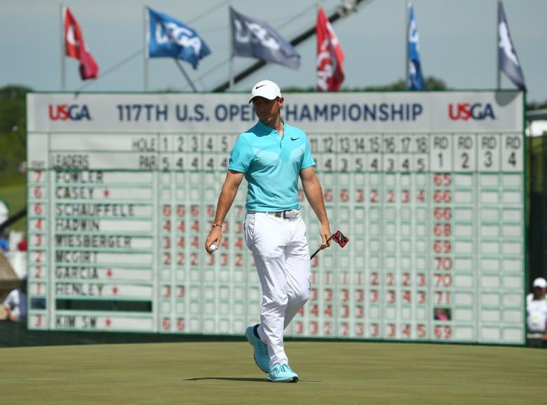 Jun 16, 2017; Erin, WI, USA;  Rory McIlroy walks off the 18th green during the second round of the U.S. Open golf tournament at Erin Hills. Mandatory Credit: Rob Schumacher-USA TODAY Sports
