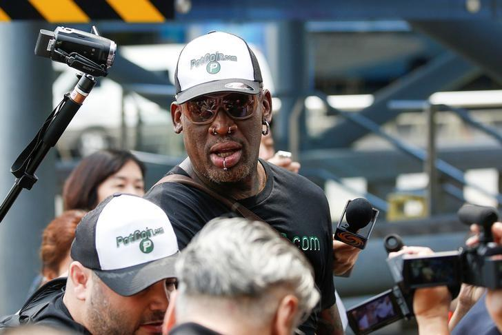 Former NBA basketball player Dennis Rodman leaves Beijing airport after arriving from North Korea's Pyongyang, China June 17, 2017.  REUTERS/Thomas Peter