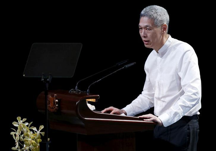 FILE PHOTO: Lee Hsien Yang, son of former leader Lee Kuan Yew, delivers his eulogy during the funeral service at the University Cultural Centre at the National University of Singapore March 29, 2015.    REUTERS/Edgar Su/File Photo