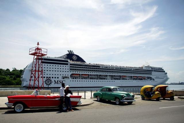 Taxi drivers wait for custumers as cruise ship MSC Opera arrives in Havana, Cuba June 17, 2017. REUTERS/Alexandre Meneghini