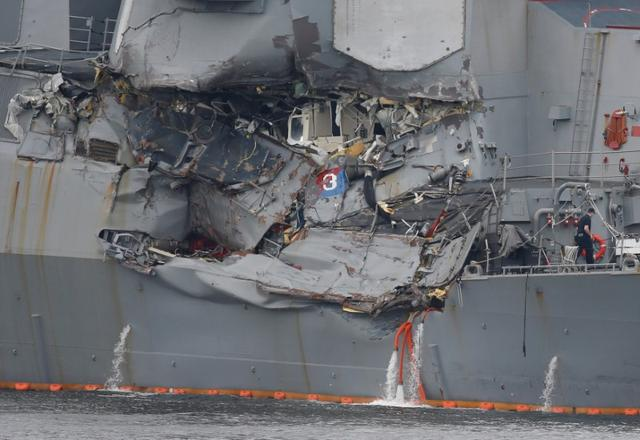 U S  destroyer almost foundered after collision, bodies