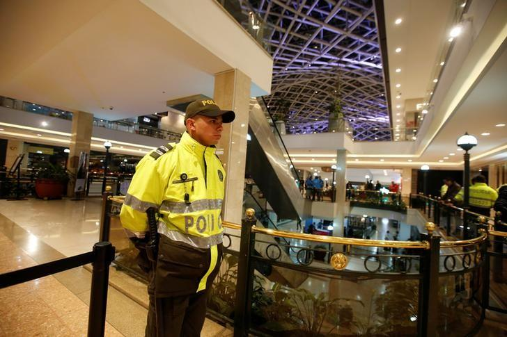 A police officer stands guard at an cordoned off area at the Andino shopping center after an explosive device detonated in a restroom, in Bogota, Colombia June 17, 2017. REUTERS/Jaime Saldarriaga