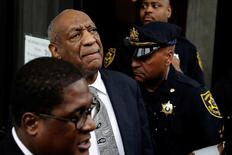 Actor and comedian Bill Cosby (C) reacts after a judge declared a mistrial in his sexual assault trial at the Montgomery County Courthouse in Norristown, Pennsylvania, U.S., June 17, 2017. REUTERS/Lucas Jackson