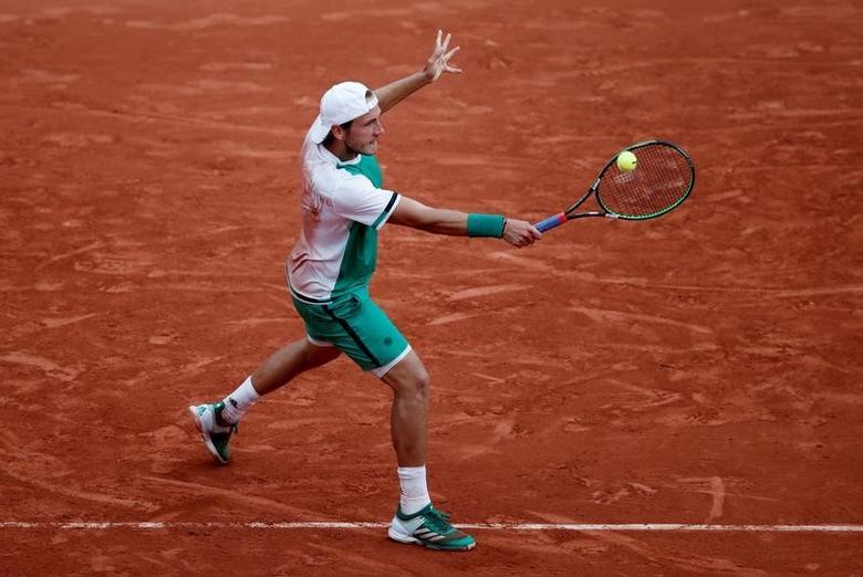 FILE PHOTO: Tennis - French Open - Roland Garros, Paris, France - June 2, 2017   France's Lucas Pouille in action during his third round match against Spain's Albert Ramos-Vinolas   Reuters / Benoit Tessier
