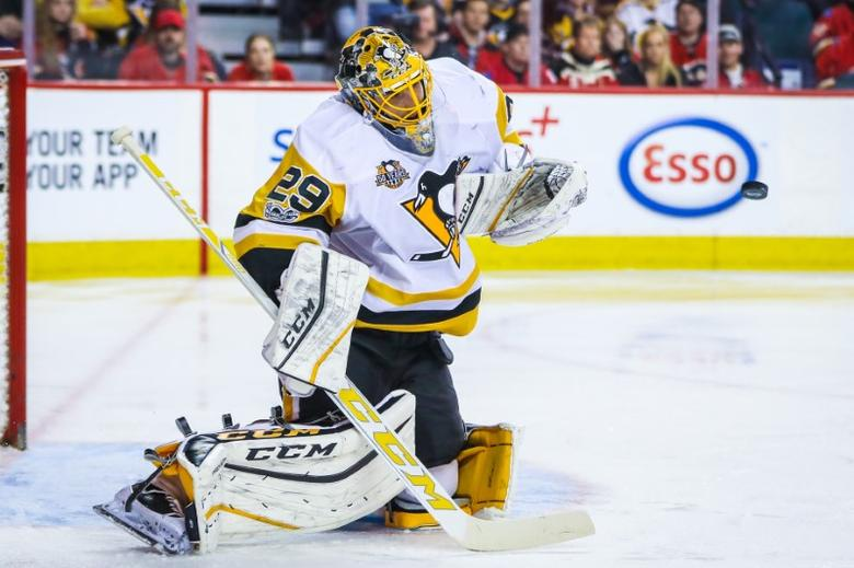 FILE PHOTO: Mar 13, 2017; Calgary, Alberta, CAN; Pittsburgh Penguins goalie Marc-Andre Fleury (29) makes a save against the Calgary Flames during the second period at Scotiabank Saddledome. Mandatory Credit: Sergei Belski-USA TODAY Sports