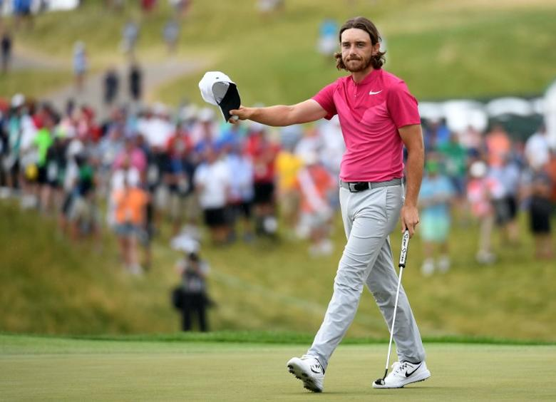 Jun 17, 2017; Erin, WI, USA;  Tommy Fleetwood tips his hat to the gallery on the 18th green during the third round of the U.S. Open golf tournament at Erin Hills. Mandatory Credit: Michael Madrid-USA TODAY Sports