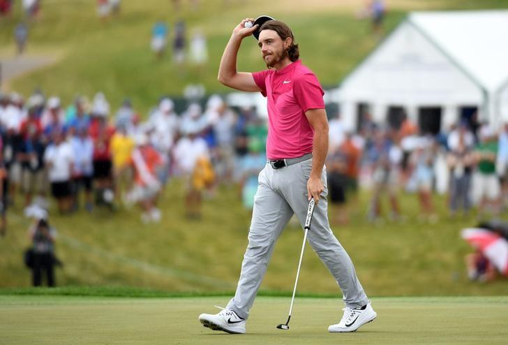 Jun 17, 2017; Erin, WI, USA;  Tommy Fleetwood tips his hat to the gallery on the 18th green during the third round of the U.S. Open golf tournament at Erin Hills. Michael Madrid-USA TODAY Sports