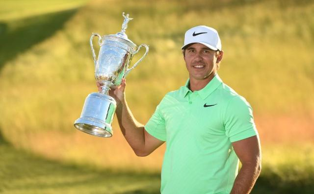 Jun 18, 2017; Erin, WI, USA; Brooks Koepka poses with the trophy after winning the U.S. Open golf tournament at Erin Hills. Mandatory Credit: Michael Madrid-USA TODAY Sports