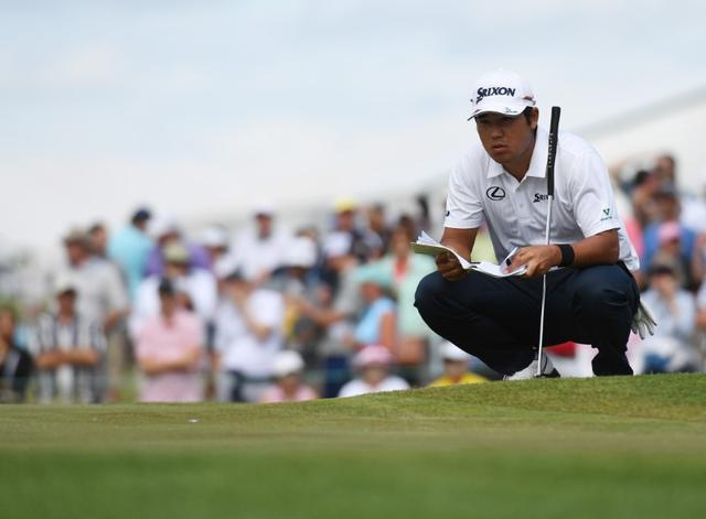 Jun 18, 2017; Erin, WI, USA;  Hideki Matsuyama reads the greens on the 9th hole during the final round of the U.S. Open golf tournament at Erin Hills.  Michael Madrid-USA TODAY Sports