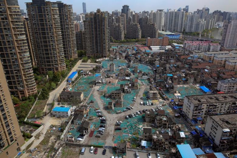 A view of old houses surrounded by new apartment buildings in Guangfuli neighbourhood in Shanghai, China, April 8, 2016. REUTERS/Aly Song