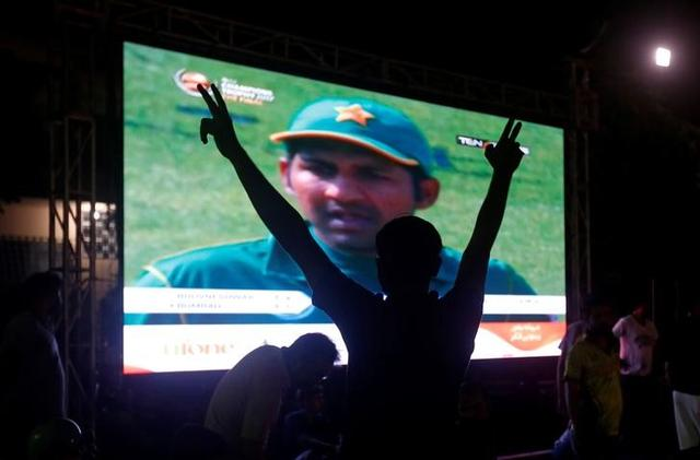 A Pakistani cricket fan makes a victory sign after Pakistan defeated India in the ICC Champions Trophy finals, in Karachi, Pakistan June 18, 2017. REUTERS/Akhtar Soomro