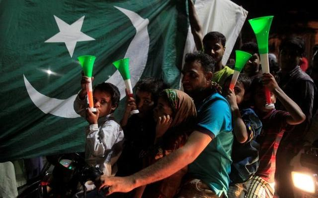 Pakistani cricket fans cheer after Pakistan defeated India in the Champions Trophy finals, in Lahore, Pakistan June 18, 2017.  REUTERSMohsin Raza