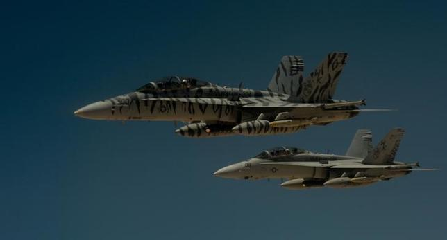 FILE PHOTO: Two U.S. Marine Corps F-18 Super Hornets depart after receiving fuel from a 908th Expeditionary Air Refueling Squadron KC-10 Extender during a flight in support of Operation Inherent Resolve May 31, 2017. U.S. Air Force/Staff Sgt. Michael Battles/Handout/File Photo via REUTERS