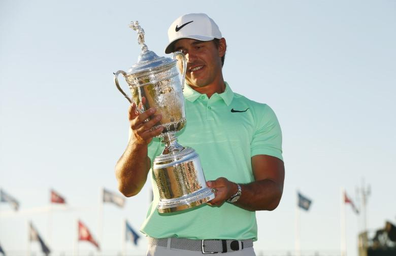 Jun 18, 2017; Erin, WI, USA; Brooks Koepka poses with the trophy after winning the U.S. Open golf tournament at Erin Hills.  Rob Schumacher-USA TODAY Sports