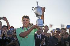 Jun 18, 2017; Hartford, WI, USA; Brooks Koepka holds up the U.S. Open Championship trophy after the final round of the 2017 U.S. Open Championship at Erin Hills. Mandatory Credit: Mike De Sisti/Milwaukee Journal Sentinel via USA TODAY NETWORK