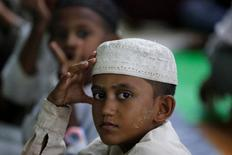 A Muslim boy sits during prayers in a mosque in Yangon June 7, 2017. Picture taken June 7, 2017 REUTERS/Soe Zeya Tun