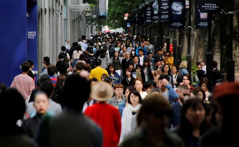 FILE PHOTO: People walk in Omotesando shopping district in Tokyo, Japan May 17, 2017. Picture taken May 17, 2017.   REUTERS/Toru Hanai/File Photo - RTX39K58