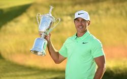 Brooks Koepka poses with the trophy after winning the U.S. Open golf tournament at Erin Hills.  Mandatory Credit: Rob Schumacher-USA TODAY Sports