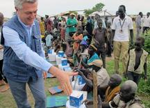 UNHCR High Commissioner for Refugees Filippo Grandi meets displaced civilians moving to a new camp in Bentiu, South Sudan June 18, 2017. REUTERS/David Lewis