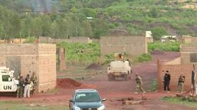 An armoured vehicle drives towards Le Campement Kangaba resort following an attack where gunmen stormed the resort in Dougourakoro, to the east of the capital Bamako, Mali in this still frame taken from video June 18, 2017. REUTERS/ REUTERS TV