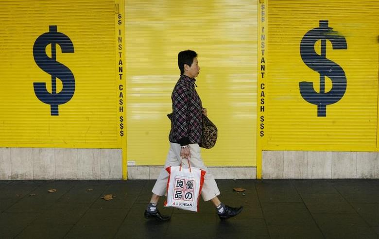 FILE PHOTO: A woman walks past a pawn office in central Sydney May 7, 2009. REUTERS/Daniel Munoz