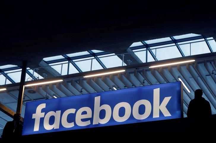 Facebook logo is seen  at a start-up companies gathering at Paris' Station F in Paris, France, January 17, 2017. REUTERS/Philippe Wojazer/Files