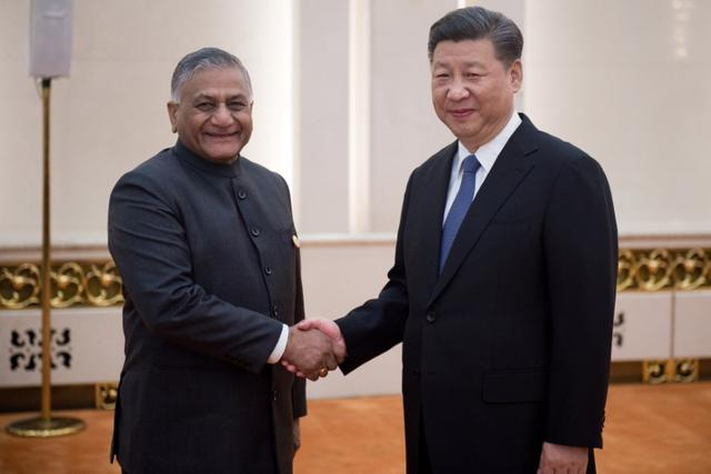 China's President Xi Jinping (R) shakes hands with Indian Minister of External Affairs Vijay Kumar Singh (L) as he meets with foreign affairs officials from the BRICS countries at the Great Hall of the People's Fujian Room in Beijing on June 19, 2017. REUTERS/Nicolas Asfouri/Pool