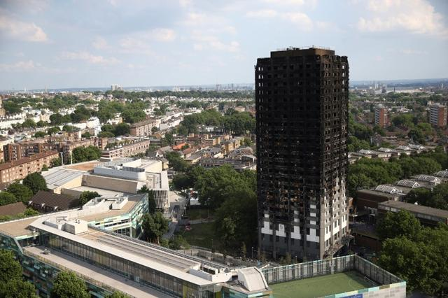The burnt out remains of the Grenfell apartment tower are seen in North Kensington, London, Britain, June 18, 2017. REUTERS/Neil Hall