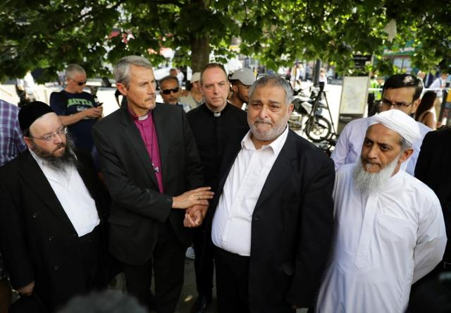 Local faith leaders stand together as they pose for photographers, near Finsbury Park Mosque, in a show of friendship following the attack outside the mosque, in London, Britain June 19, 2017.  REUTERS/Kevin Coombs