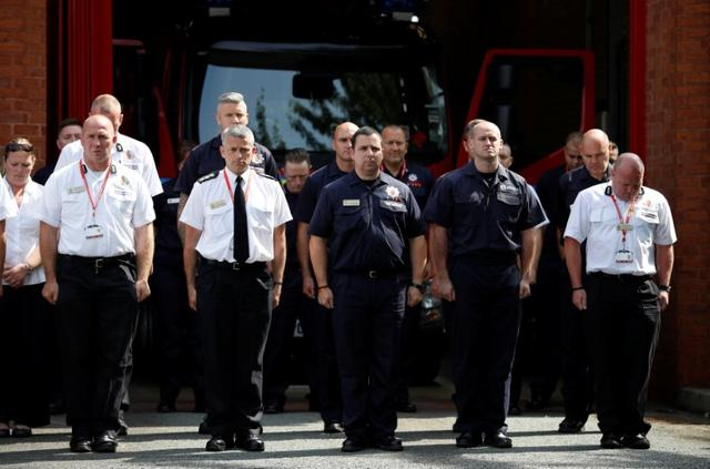 Firefighters from the Manchester Central Community Fire Station observe a minute's silence in memory of the victims of the fire that destroyed London's Grenfell Tower block, in Manchester June 19, 2017.  REUTERS/Phil Noble