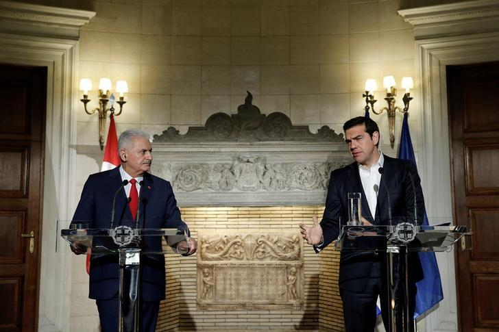 Greek Prime Minister Alexis Tsipras (R) speaks during a joint news conference with his Turkish counterpart Binali Yildirim after their meeting at the Maximos Mansion in Athens, Greece, June 19, 2017. REUTERS/Costas Baltas