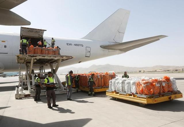 Workers load export materials into a Cargo plane in Kabul, Afghanistan. June 19, 2017. REUTERS/Omar Sobhani