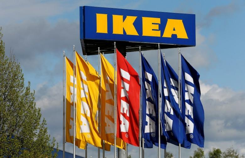 FILE PHOTO: Flags and the company's logo are seen outside of an IKEA Group store in Spreitenbach, Switzerland April 27, 2016. REUTERS/Arnd Wiegmann/File Photo