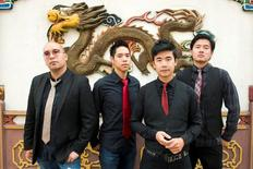 Members of the Portland, Oregon-based Asian-American rock band The Slants (L-R) Tyler Chen, Ken Shima, Simon Tam, Joe X. Jiang pose in Portland, Oregon, U.S., August 21, 2015 in a picture released by band representatives.  Anthony Pidgeon/Handout via Reuters