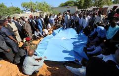 Relatives and government officials bury the dead body of Somalia's public works minister Abbas Abdullahi Sheikh Siraji who was shot and killed in the capital Mogadishu, Somalia May 4, 2017. REUTERS/Feisal Omar