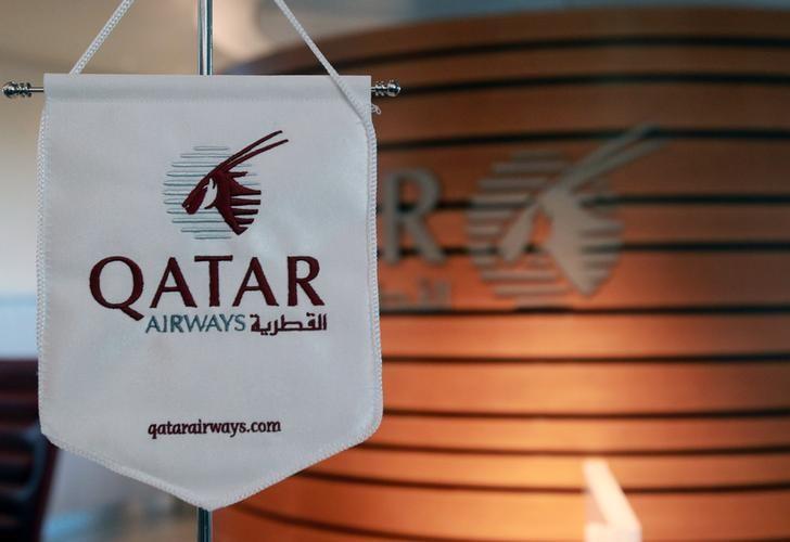 A logo of Qatar Airways is seen at Hamad International Airport in Doha, Qatar June 12, 2017. REUTERS/Naseem Zeitoon