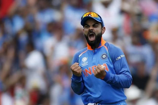 Britain Cricket - Pakistan v India - 2017 ICC Champions Trophy Final - The Oval - June 18, 2017 India's Virat Kohli celebrates the wicket of Pakistan's Shoaib Malik Action Images via Reuters / Paul Childs Livepic