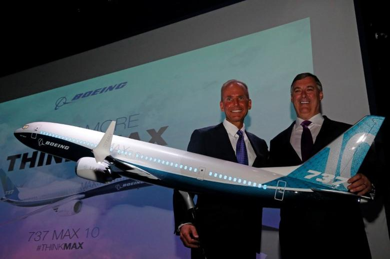 Boeing Chairman and CEO Dennis Muilenburg and Boeing Commercal Airplanes President Kevin McAllister are seen at the launch of the Boeing 737 MAX 10, on the first day of the 52nd Paris Air Show at Le Bourget airport near Paris, France, June 19, 2017. REUTERS/Pascal Rossignol