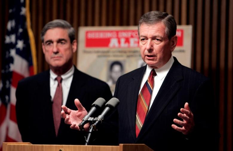 FILE PHOTO --  U.S. Attorney General John Ashcroft (R) and FBI Director Robert Mueller speak about possible terrorist threats against the United States, in Washington, May 26, 2004.  REUTERS/Kevin Lamarque/File Photo