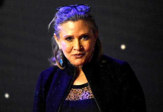 FILE PHOTO: Carrie Fisher poses for cameras as she arrives at the European Premiere of ''Star Wars, The Force Awakens'' in Leicester Square, London, December 16, 2015.     REUTERS/Paul Hackett/File Photo