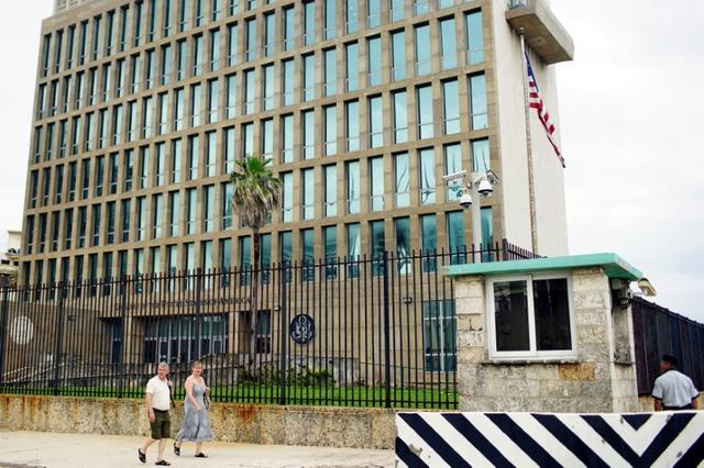People walk past the U.S. Embassy in Havana, Cuba, June 19, 2017. REUTERS/Alexandre Meneghini