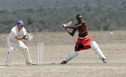 "Daniel Mamai of the Maasai Cricket Warriors plays against the British Army Training Unit (BATUK) cricket team during a charity tournament called the ""Last Male Standing Rhino Cup"" at the Ol Pejeta Conservancy in Laikipia, Kenya June 18, 2017. REUTERS/Thomas Mukoya"