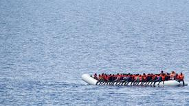 "Migrants wait to be rescued by ""Save the Children"" NGO crew from the ship Vos Hestia in the Mediterranean sea off Libya coast, June 18, 2017. REUTERS/Stefano Rellandini"