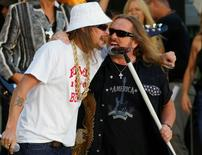 "FILE PHOTO - Singer Kid Rock (L) performs with Johnny Van Zant (R) and his band Lynyrd Skynyrd on ABC's ""Good Morning America"" in New York, U.S. on August 22, 2008.   REUTERS/Brendan McDermid/File Photo"