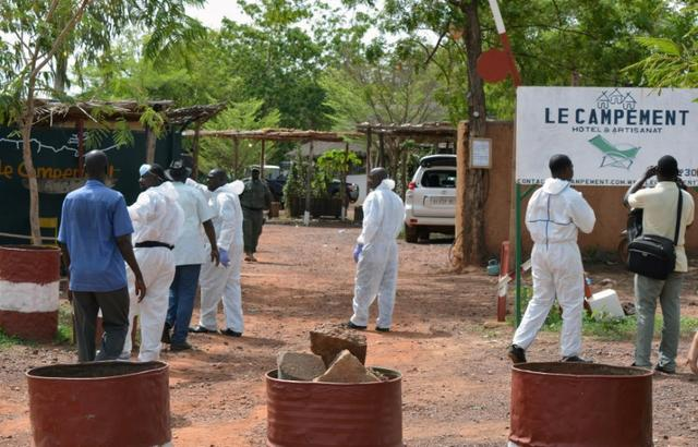 Malian investigators walk at the entrance of the Kangaba tourist resort following an attack where gunmen stormed Le Campement Kangaba in Dougourakoro, to the east of the capital Bamako, Mali June 19, 2017. REUTERS/ Stringer
