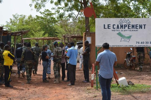 People gather at the entrance of the Kangaba tourist resort following an attack where gunmen stormed Le Campement Kangaba in Dougourakoro, to the east of the capital Bamako, Mali June 19, 2017. REUTERS/ Stringer