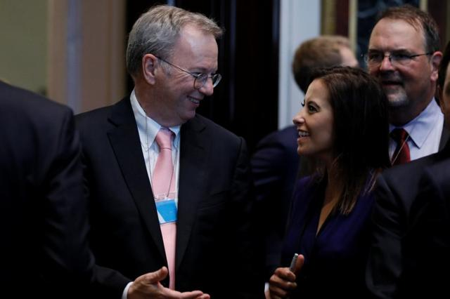 Alphabet Executive Chairman Eric Schmidt (L) speaks with U.S. Deputy National Security Advisor Dina Powell (R) as tech company leaders gather at a summit of the American Technology Council at the Eisenhower Executive Office Building in Washington, U.S. June 19, 2017.  REUTERS/Jonathan Ernst
