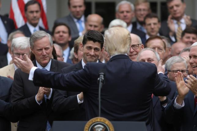 FILE PHOTO - U.S. President Donald Trump (C) turns to House Speaker Paul Ryan (3rdL) as he gathers with Congressional Republicans in the Rose Garden of the White House after the House of Representatives approved the American Healthcare Act, to repeal major parts of Obamacare and replace it with the Republican healthcare plan, in Washington, U.S., May 4, 2017. REUTERS/Carlos Barria