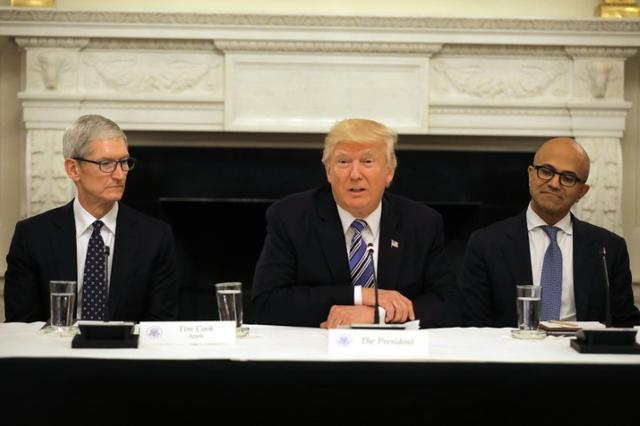 U.S. President Donald Trump participates in an American Technology Council roundtable, accompanied by Tim Cook, CEO of Apple (L) and Satya Nadella CEO of Microsoft Corporation at the White House in Washington, U.S., June 19, 2017. REUTERS/Carlos Barria